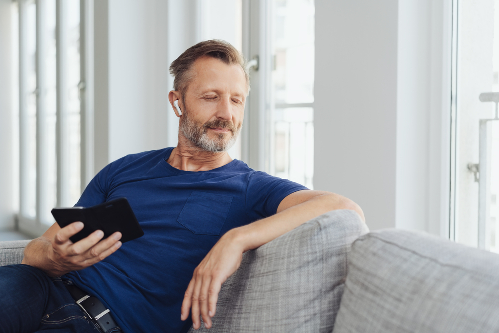 Middle aged man listening to music